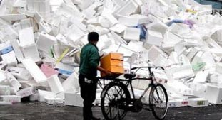 Styrofoam Recycling Arizona Man facing pile of Styrofoam